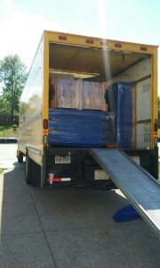 picture of home furnishings wraped and loaded on moving truck